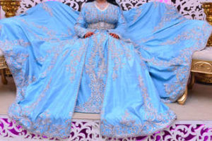 Moroccan caftan in blue. Dressed by the Moroccan bride on her wedding day. Moroccan caftan is one of the most famous traditional clothing in the world Banque d'images - 156502299
